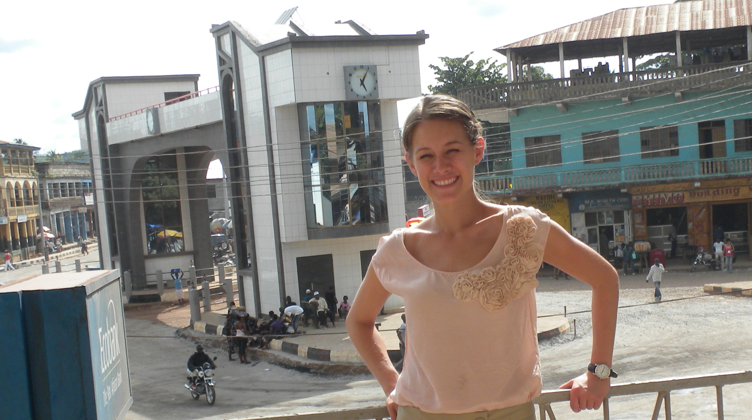 Reta in Makeni, standing on the balcony of Access to Justice Law Centre.