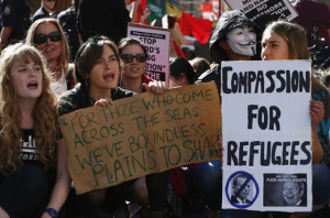 Demonstrators shout slogans against the government during a rally in support of asylum seekers in central Sydney